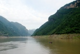 The river goes from wide to narrow between gorges